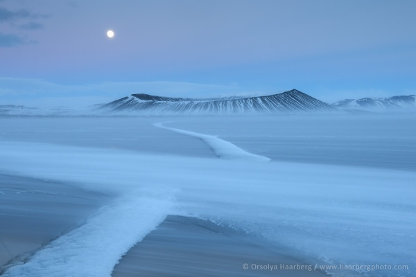 The Hverfjall crater in early spring with full Moon, Iceland.